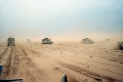 Abrams tanks of the 1st Armored Division 7th Corps move across the desert in northern Kuwait during Operation Desert Storm. Feb. 28 1991.