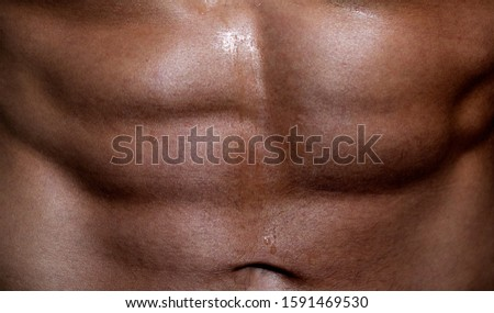 Abs. Closeup torso. Workout. Bodybuilder with muscular torso and ripped abs
