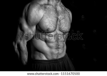 Abs concept. Torso with six pack abs. Workout abs. Exercise abs, copy space, black and white.
