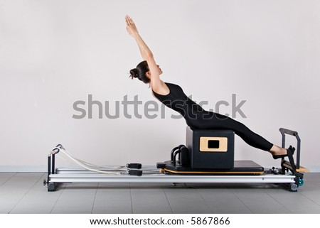 ABS on the short box position. Pilates gymnastics is a Germanic evolution of yoga, used by athletes to improve flexibility and body fitness and by chiropractors for patient recovery. - stock photo