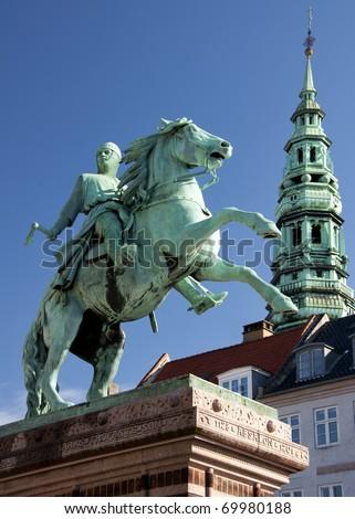 Absalon, founder of Copenhagen, on his horse against blue skies. - stock photo