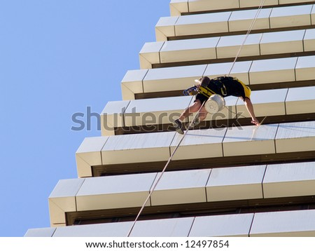 abseiling window cleaners series - landscape orientation close up of man stretched out