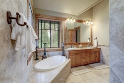 Absolutly stunning bathroom interior deisgn in a luxury rustic cabin style American home with stone and wood, venetian plaster and caling tones.