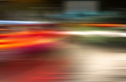Absrtact  blurred lights of moving cars in the night city.Bokeh urban background. Blurred  moving  traffic