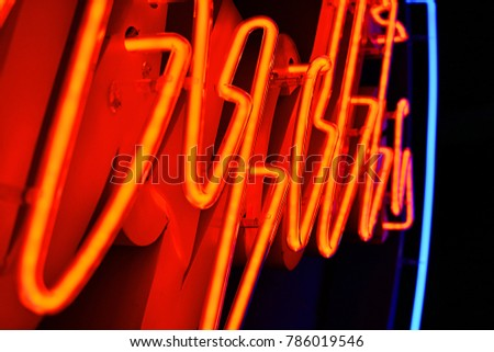 Abstact red neon sign with a blue neon tube in the background #786019546