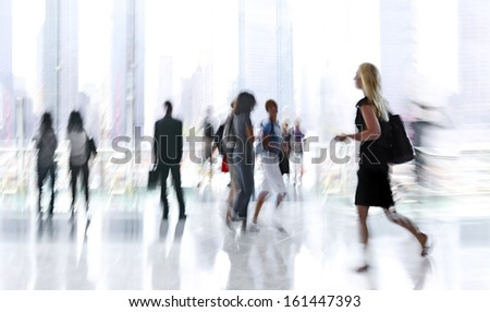 abstakt image of people in the lobby of a modern business center with a blurred background