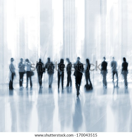 abstakt image of people in the lobby of a modern business center with a blurred background and  blue tonality