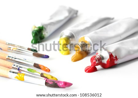 Abstract acrylic paint, paint tubes and brushes isolated on white