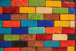abstract aged multicolored painted baked earthen clay brick blocks, colorful architectural structure design, exterior wall background, wallpaper, backdrop, building decoration, painting, creativity