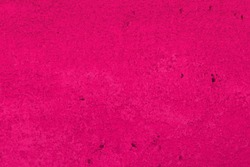 abstract aged pink limestone texture for use as background.