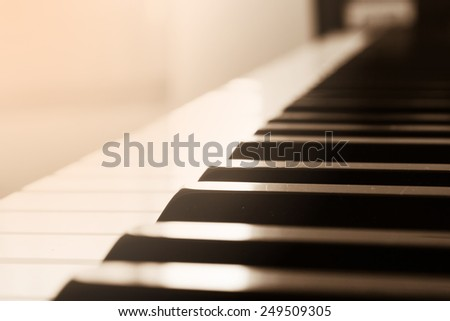 Abstract and blur background. Closeup piano keyboard. Sepia tone. With color filter.