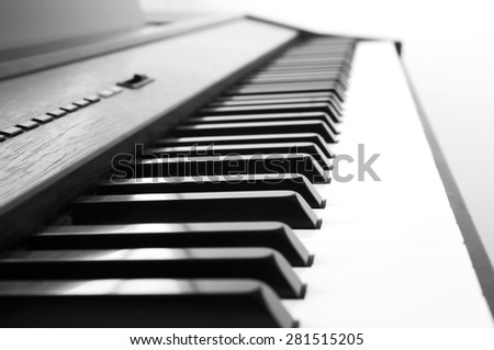 Abstract and blur background of Piano keyboard. Black and white theme with color filter.