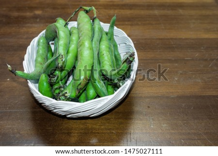 Abstract and conceptual of Fava beans on wood background. Ingredient widely used in the kitchen.