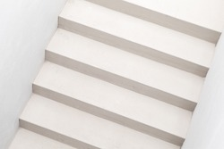 Abstract architecture background photo. White stairs, top view, empty interior fragment