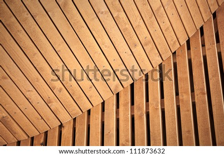 Abstract architecture background with wooden planking curved construction. Scandinavian natural design example.