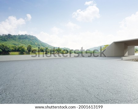 Abstract architecture design of modern building. Empty parking area floor and concrete wall with mountain and blue sky lake view. 3D rendering background image for car scene.