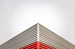 Abstract Architecture Detail Of A Factory Roof Corner Against An Overcast Sky With Copy Space