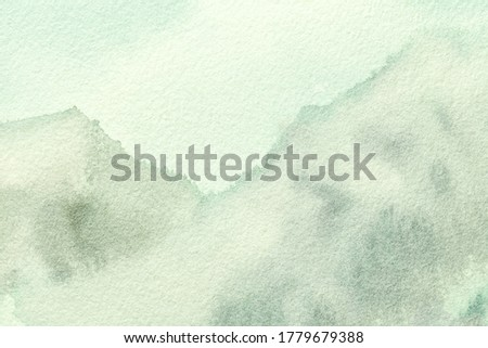 Abstract art background light olive and green colors. Watercolor painting on canvas with soft ivory gradient. Fragment of artwork on paper with pattern. Texture backdrop.