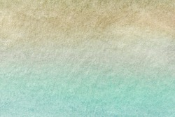 Abstract art background light turquoise and beige colors. Watercolor painting on canvas with soft brown and cyan gradient. Fragment of artwork on paper with olive pattern. Texture backdrop.