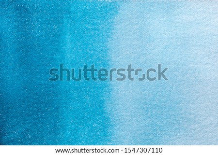 Abstract art background light turquoise and navy blue colors. Watercolor painting on canvas with soft cyan gradient. Fragment of artwork on paper with pattern. Texture azure backdrop.
