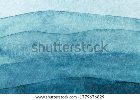 Abstract art background navy blue colors. Watercolor painting on canvas with turquoise pattern of sea waves. Fragment of artwork on paper with wavy line and gradient.