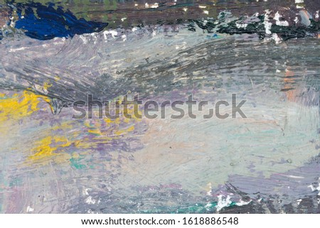 Abstract art background. Original oil painting on canvas. Fragment of artwork. Brushstrokes of paint. Colorful mural. Modern art. Contemporary art. Blue and Yellow. Impressionism in detail.