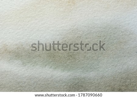 Abstract art background white and gray colors. Watercolor painting on canvas with soft ivory gradient. Fragment of artwork on paper with light olive pattern. Texture backdrop.