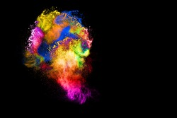 Abstract art colored powder  on black background. Movement frozen colored dust explosion multicolored on black background.