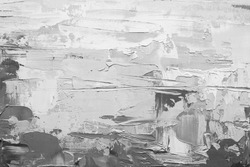 Abstract art. Grunge background. Oil painting on canvas. Black and white texture. Fragment of artwork. Spots of oil paint. Brushstrokes of paint. Modern art. Contemporary art.