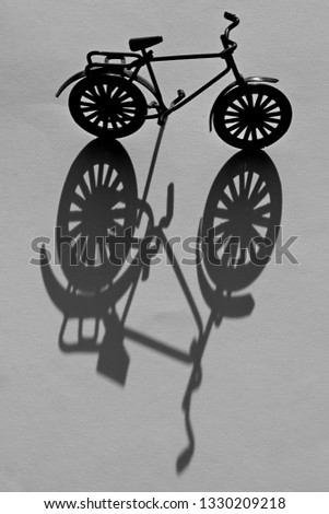 Abstract artistic Bicycle silhouette from metal bike with a light and shadow play showing a modern art picture