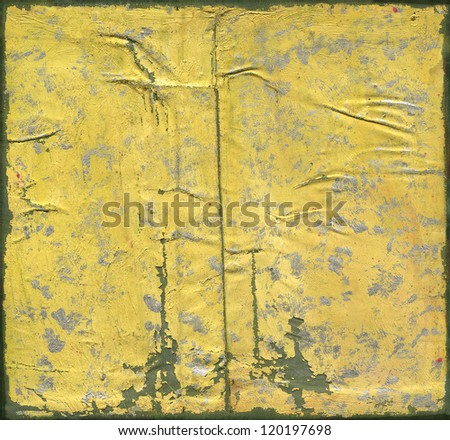 Abstract artistic painted grunge background, yellow with silver brush strokes, green painted frame and peeling paint texture.