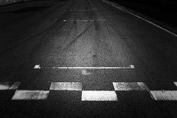 Abstract asphalt black Start and Finish grid line for race car in circuit texture background, Automobile and automotive background concept.