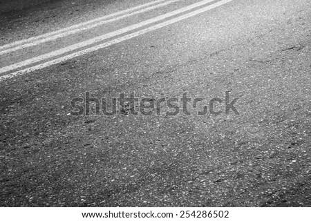 Abstract asphalt road fragment, automotive transportation background, double dividing line