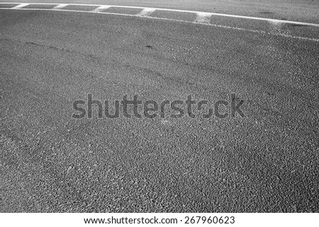 Abstract asphalt road fragment with marking lines, automotive transportation background