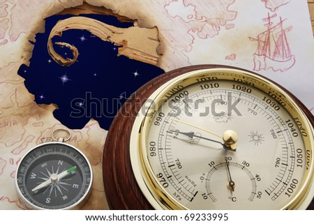 Abstract. Astral sky in hole of old chart. Compass and barometer