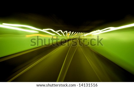 Abstract auto tunnel in Amsterdam with green blurred lights