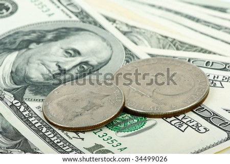 Abstract background: American dollars: bills and coins close-up. Shallow DOF