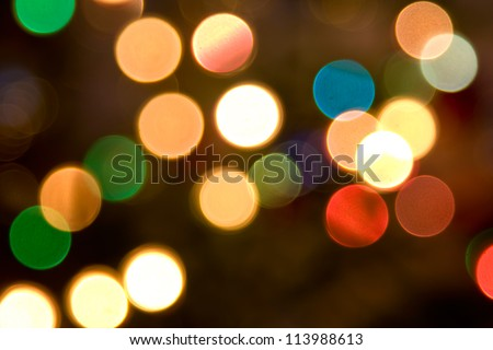 Abstract background. Blurred colorful circles bokeh of christmas lights