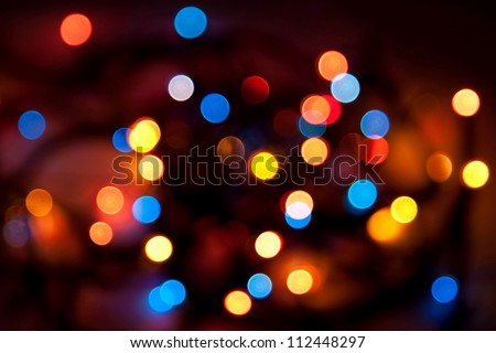 Abstract background - blurred colorful circles bokeh of Christmaslight against dark background
