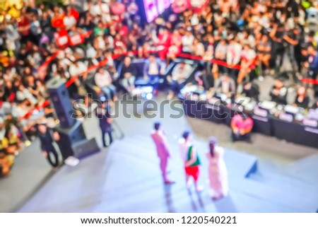 Abstract background Blurred crowd of people watching host and contestant in the contest at the hall for background,Bird eye views #1220540221