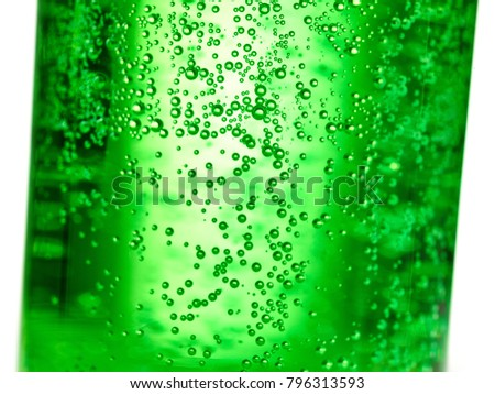 Stock Photo abstract background : bubble of sparkling water soda on the green glass bottle with gradient light