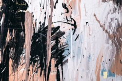 Abstract background chaotically smeared with acrylic paint. Image of a light blue, beige, brown and black strokes of brush with texture of wet stucco.  stains on canvas