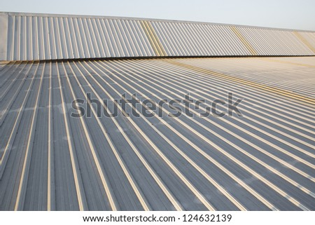 abstract background created by the surface of a metal roof industrial - stock photo