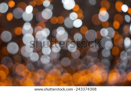 Abstract background defocused orange and white lights
