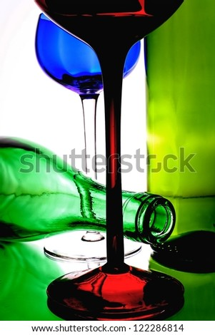 Abstract background design made from an empty  wine glasses and bottles. - stock photo