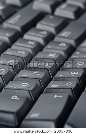 Abstract background from black computer keyboard. Shallow DOF. Close up.