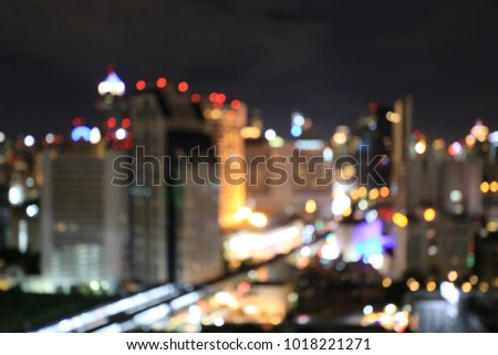 abstract background from blurred business city center light from office building downtown at night with urban