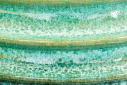 Abstract background from colorful wall ceramic jar,green,yellow and orange:ideal use for background.