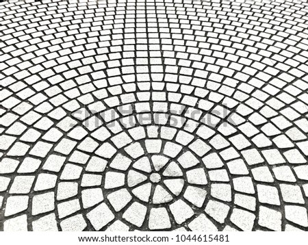 Abstract Background From Old Grey Bricks On Footpath In Garden Circle Shape 1044615481