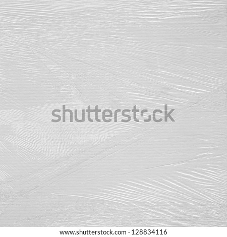 Abstract background from plastic packaging film in the sunshine
